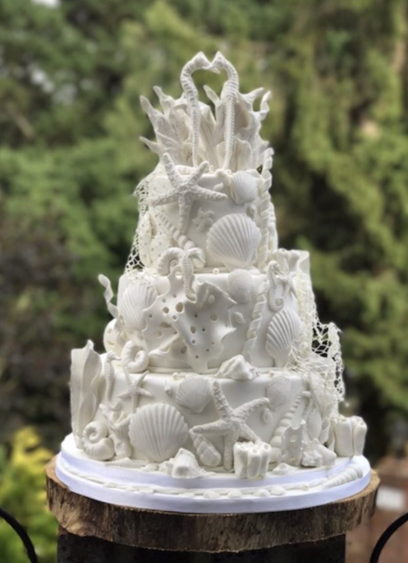 White shells beach wedding cake. Off to Kent for beach wedding & oyster festival.