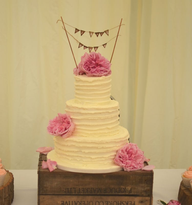 Buttercream frosted with pink peonies at Corfe Castle.