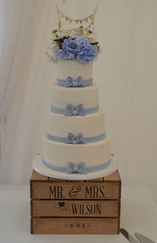 Powder blue bows wedding cake at The Three Tuns