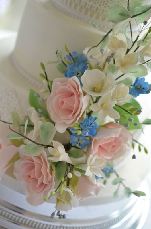 Sugar wired flowers. on champagne and lace wedding cake at The Italian Villa
