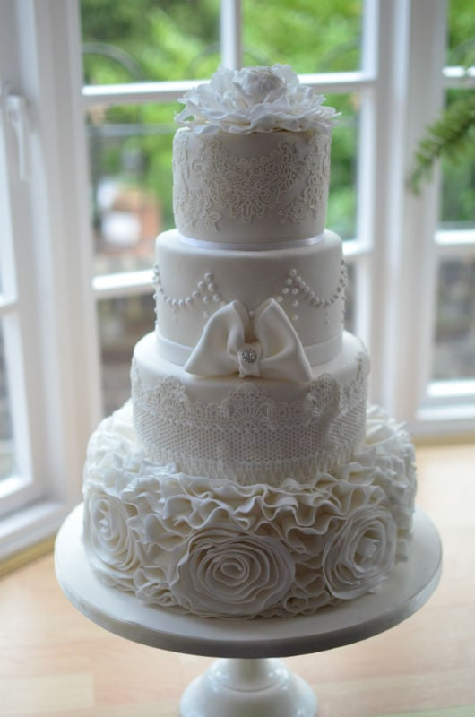 Off white ruffles & lace wedding cake delivered to The East Close hotel.