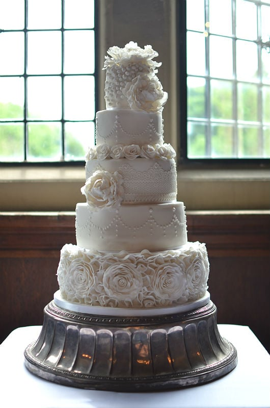 Traditional white 5 tier wedding cake at Rhinefield House