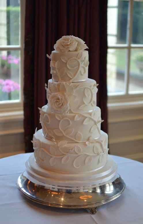White roses & trailing leaves wedding cake at The Chewton Glen Hotel