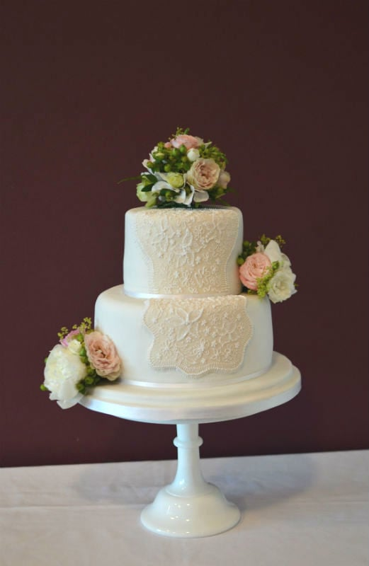 Two tier lace and fresh flowers at The Captains Club Christchurch.