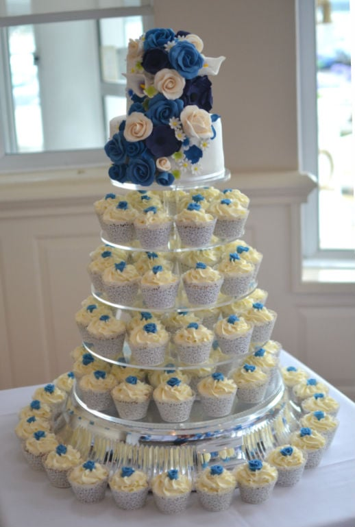 Cascading roses wedding cake with rose cupcakes at FJB Haven Hotel.