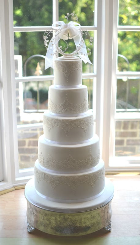 Traditional white 5 tier lace wedding cake