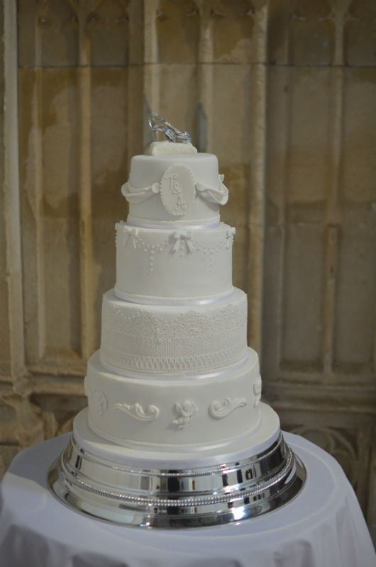 White cherub wedding cake with crystal sipper at Highcliffe Castle.