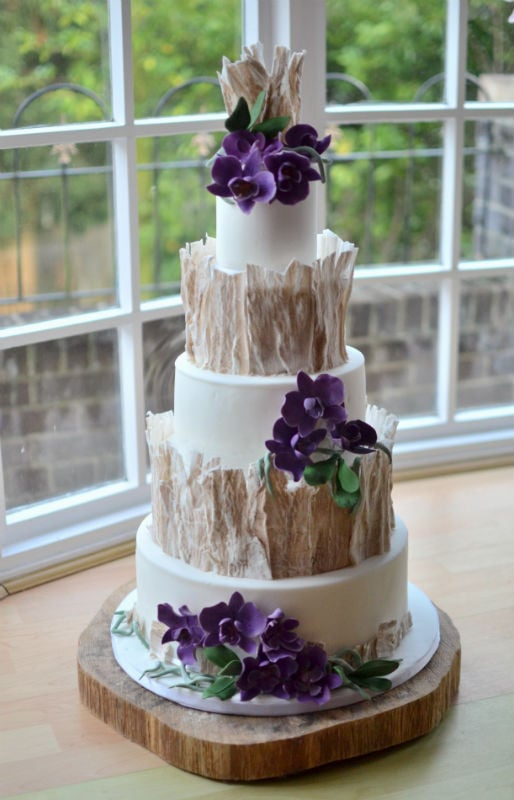Woodland wedding cake with handmade sugar orchids.