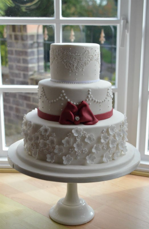 Lace Burgundy Bow Wedding Cake Delivered To Rhinefield House
