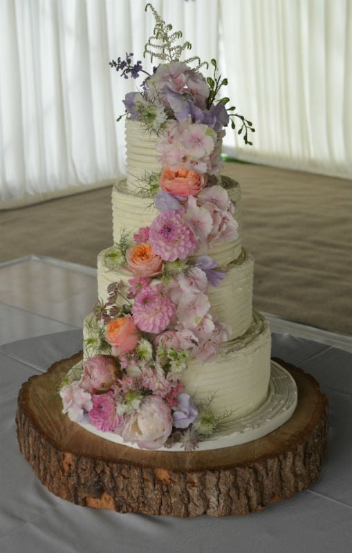 Buttercream iced with fresh flowers at Hill Place Swanmore Nr Winchester.