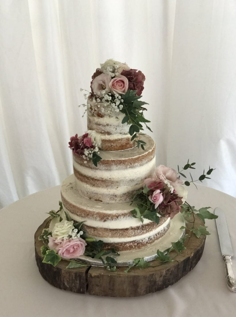 Semi-naked wedding cake at Parley Manor flowers by Simply Flower