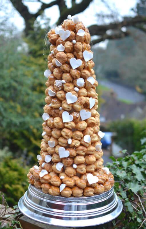 Croquembouche with white sugar hearts & almonds.
