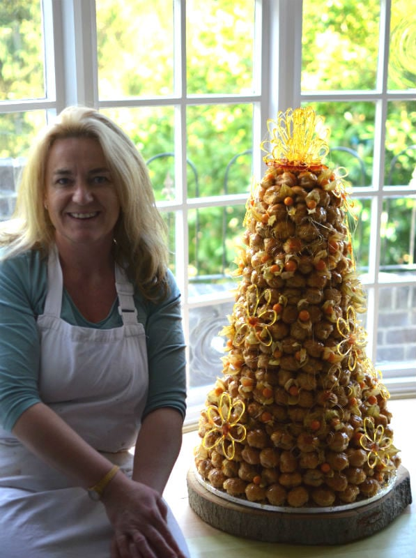 Large Summer croquembouche with sugar daisies.