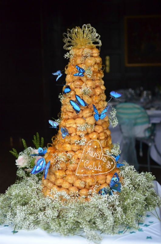 Croquembouche wedding cake with butterflies, toffee heart & crown